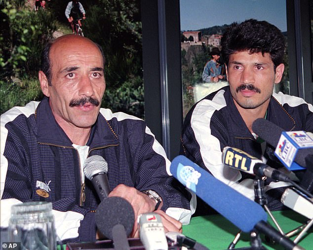 The day before the game in France, Daei (right) and his team, including coachJalal Talebi (pictured) were given orders from Khameini not to walk towards the American team