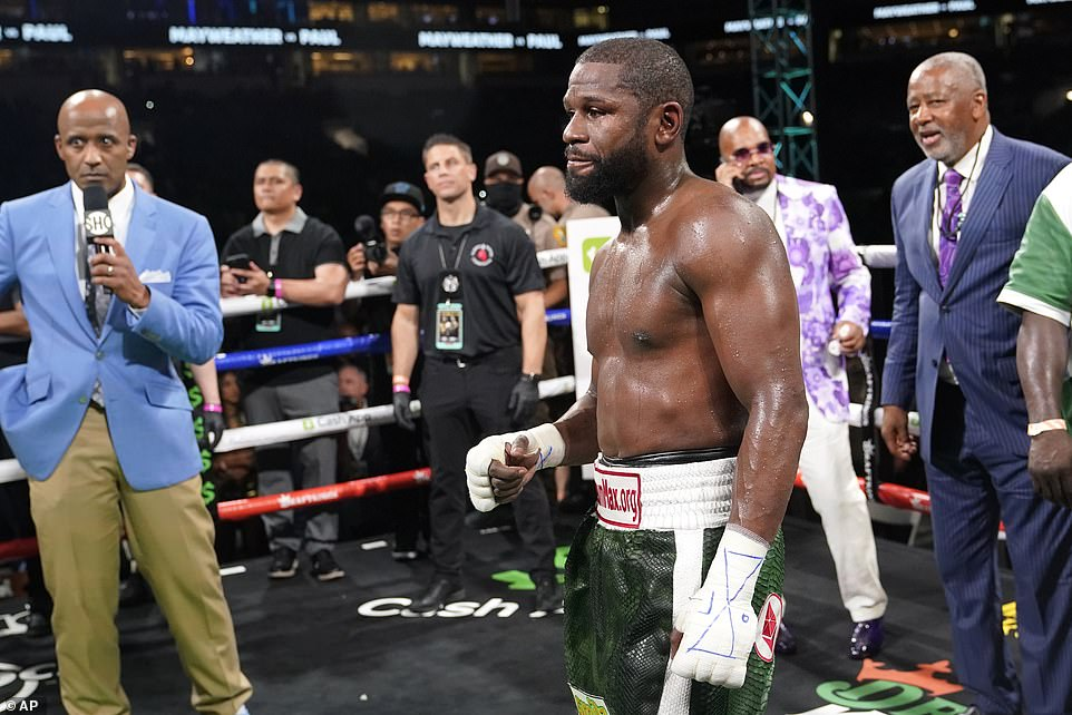 Speaking afterwards, Mayweather said: 'I wanted to give people a show and he was fighting to survive, he was the bigger guy but his background was wrestling so was good at tying me up... A guy that's retired, training a few days a week, for me to be retired, be a grandfather and fight a guy in his 20's. When the money comes, we will see who the winner is.'