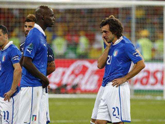 Italy players are dejected after losing in the final of Euro 2012