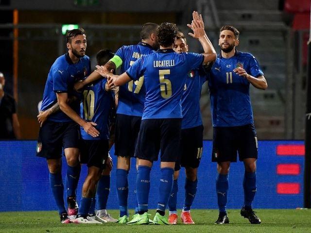 Italy's Domenico Berardi celebrates scoring their fourth goal with teammates on June 4, 2021